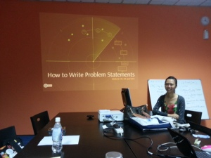 Kimberly Chu sharing 'How to Write Problem Statements'.